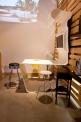diseño e interiorismo sostenible-oscar santome-panelado pales y mesado LG-diseño showroom coruña